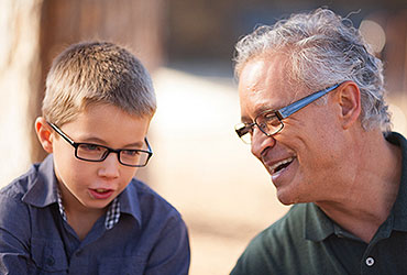 Grandfather and Grandson with Glasses